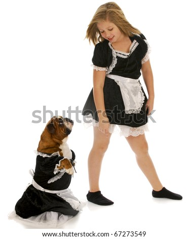 young girl playing dress up with english bulldog with reflection on white background - stock photo