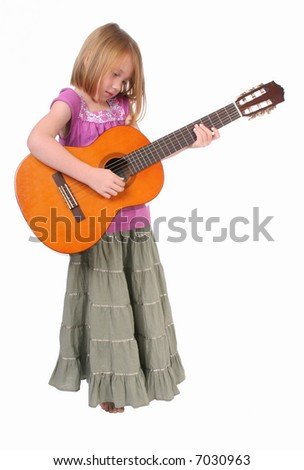 Young girl playing guitar - stock photo