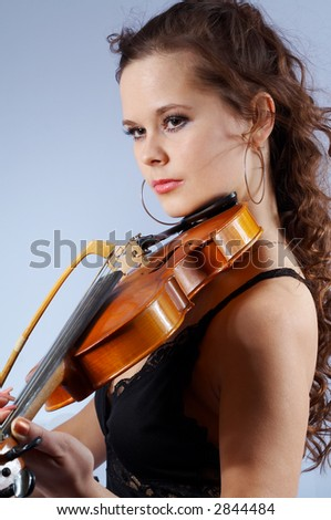 young girl playing her violin - stock photo