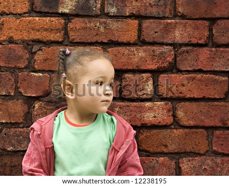 Young girl playing in an alley - stock photo