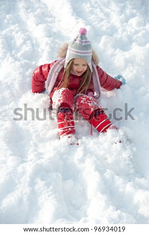 Young girl playing on the snow. - stock photo