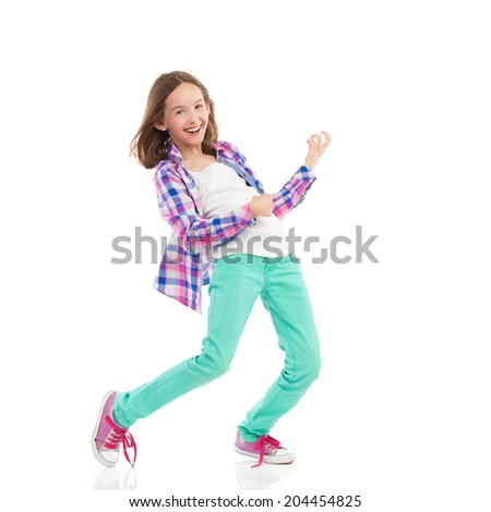 Young girl playing the air guitar. Full length studio shot isolated on white. - stock photo