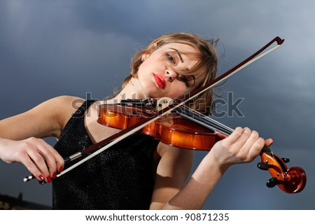 Woman Plays Cello Stock Photos, Images, & Pictures ...