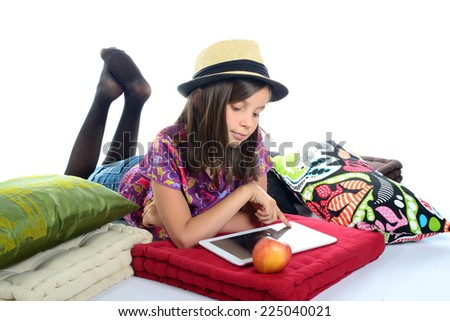 young girl playing with a digital tablet - stock photo
