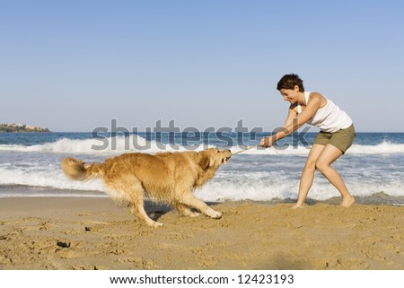 Young girl playing with her dog