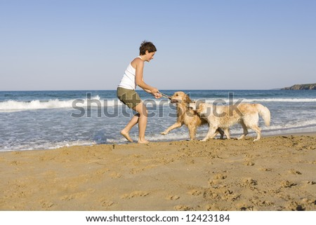 Young girl playing with her dogs