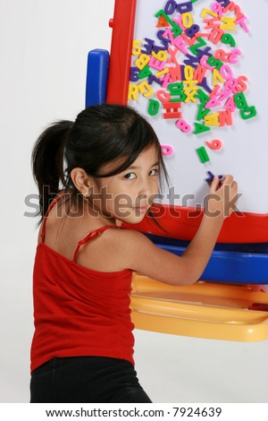 Young girl playing with letters - stock photo