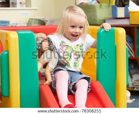 Young girl playing with toys - stock photo