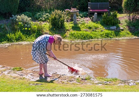 Young girl playing with water