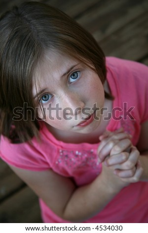 Young girl pleading or praying - stock photo
