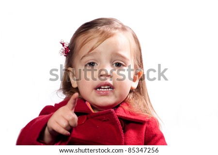 young girl pointing at the camera