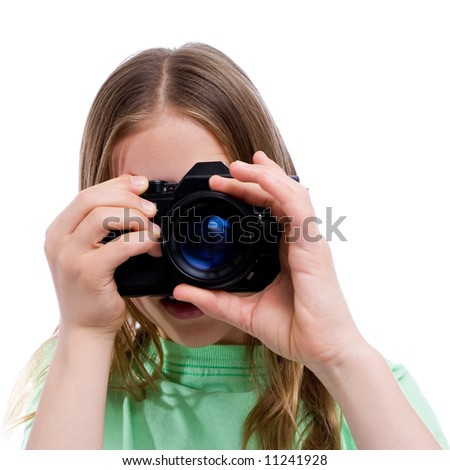 young girl pointing her camera at you - stock photo