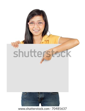 young girl pointing into white blank card - stock photo