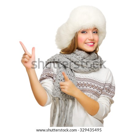 Young girl points finger up isolated - stock photo