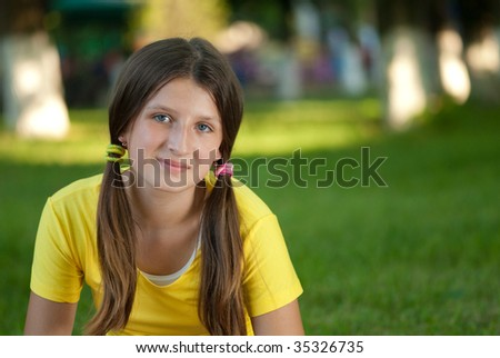Young girl portrait in sunny summer park - stock photo