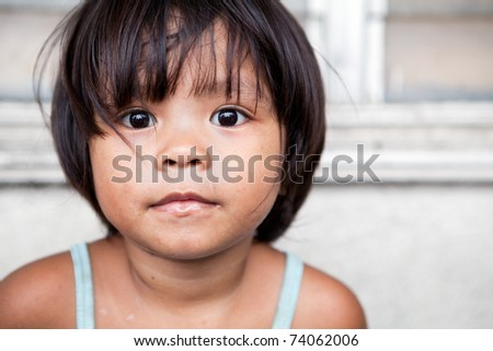 Young girl portrait in the Philippines. Filipina child living in poverty. - stock photo