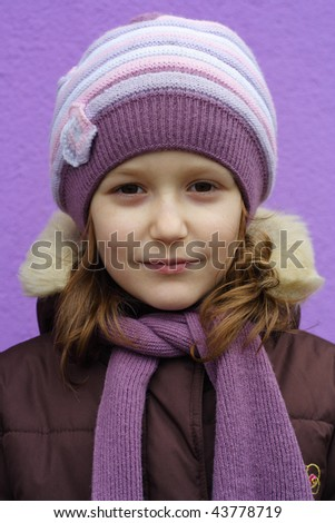 young girl portrait on a violet background
