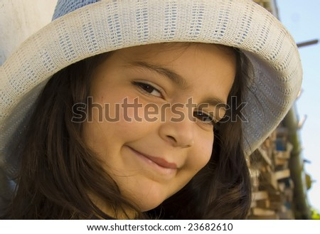 young girl portrait with hat - stock photo