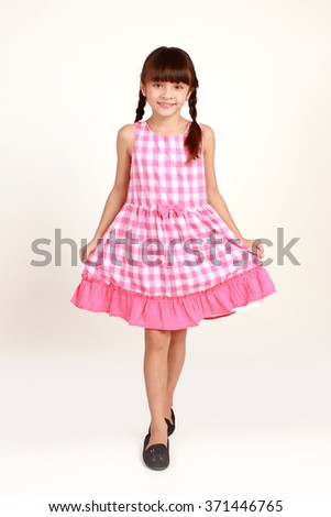young girl poses for a picture isolated on white - stock photo