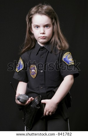 Young girl posing as a Police Officer - stock photo
