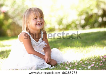 Young girl posing in park - stock photo