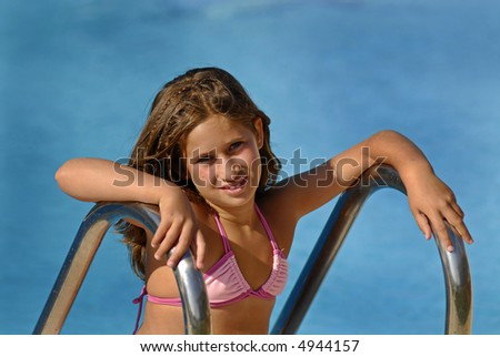 Young girl posing in the pool