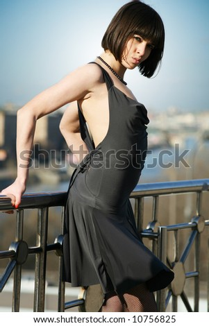 Young girl posing on the roof - stock photo