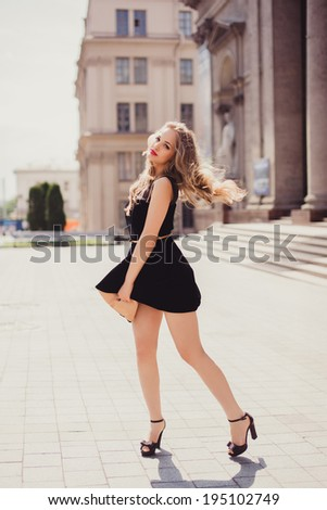 young girl posing on the street