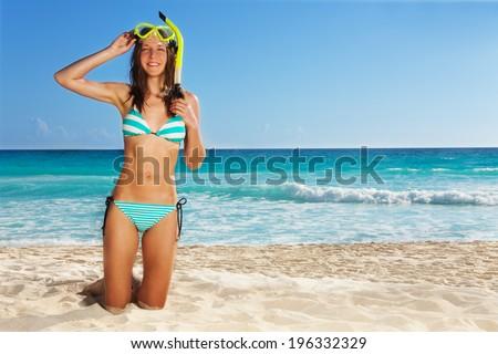 Young girl posing wearing scuba - stock photo