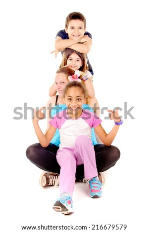 young girl posing with kids isolated in white
