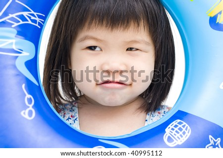 young girl posing with swim float - stock photo