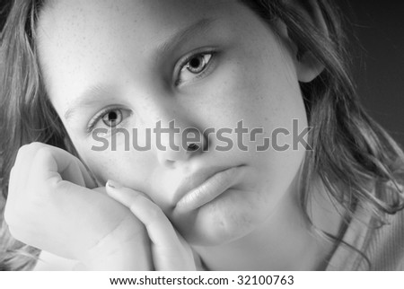 young girl pouting and looking unhappy