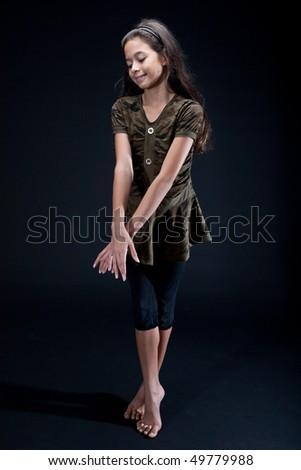 Young girl practicing her ballet dance in studio - stock photo