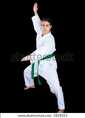 Young girl practicing karate katas - stock photo
