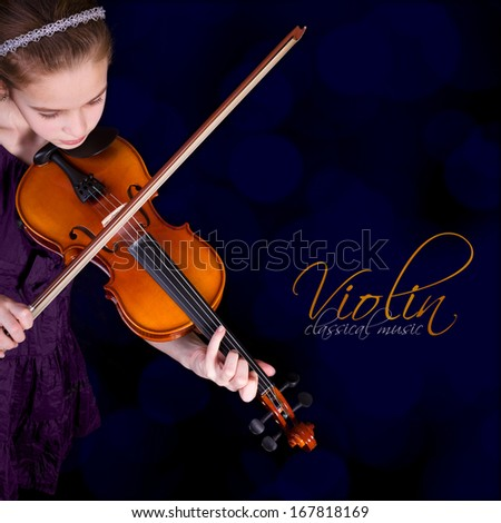 Young girl practicing the violin.