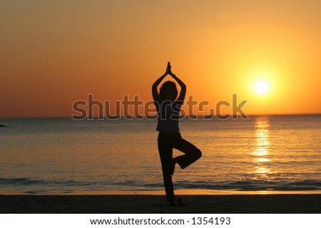 Young Girl practicing Yoga at Sunset.Tel Aviv,Israel - stock photo
