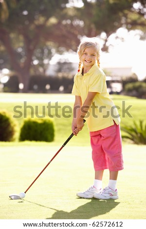 Young Girl Practising Golf On Putting On Green - stock photo