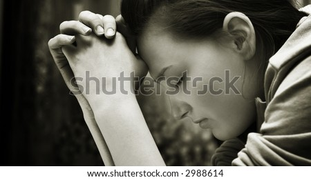 Young girl praying - stock photo