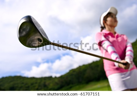 young girl preparation to drive golf - stock photo