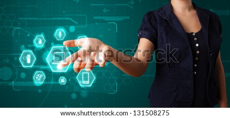 Young girl pressing virtual media type of buttons - stock photo