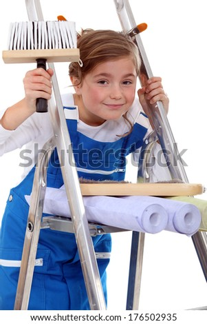 Young girl pretending to be a painter - stock photo