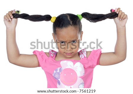 young girl pulling her hair and an expression of anger - stock photo