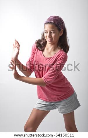 Young girl pushing imaginary wall - stock photo