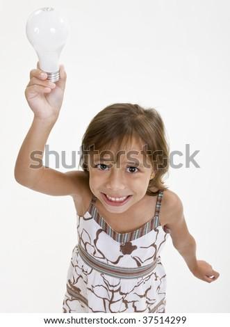 Young girl raises a standard lightbulb lamp above her head. - stock photo