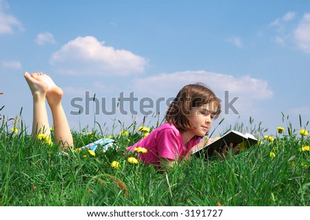 Young girl reading a book
