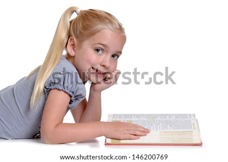 young girl reading a book white background - stock photo