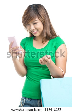 Young girl reading a message on her phone - stock photo