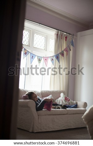 Young girl reading in her room with Cat - stock photo