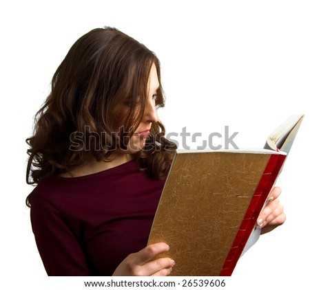 young girl reads a book. Isolation on white background - stock photo