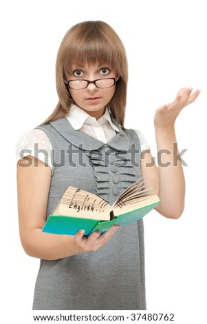Young girl reads english and is amazed on white background - stock photo